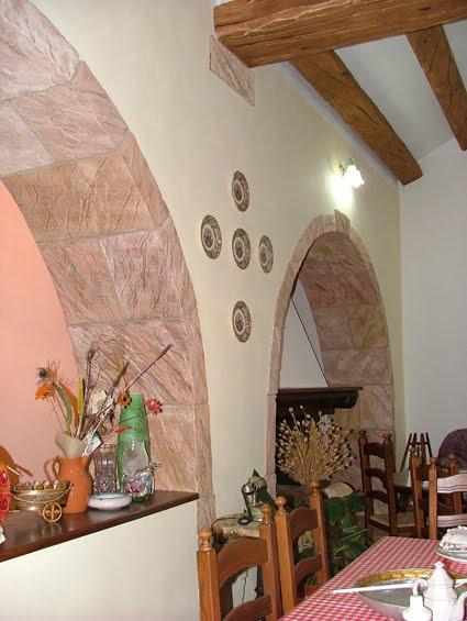 Valorizzare un architettura in relazione alla sua storia creazioni d 39 arte di giorgio sedda - Archi interni rivestiti in pietra ...